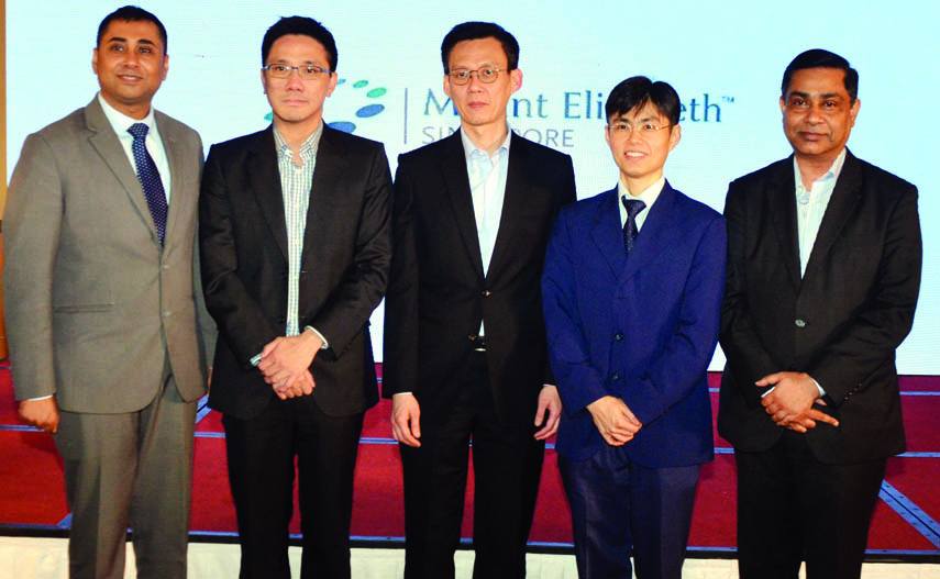 Dr Paul Chiam, Senior Consultant, Cardiology of Mount Elizabeth Hospital, Singapore along with other physicians poses for photograph at a seminar organised on detection of kidney and heart diseases at Hotel Lake Shore in the city on Sunday.