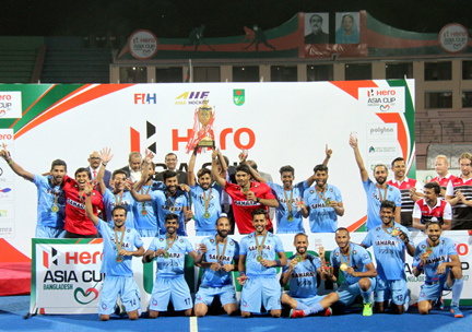 Members of India, the champions of the 10th Hero Asia Cup Hockey with the guests pose for a photo session at the Moulana Bhashani National Hockey Stadium on Sunday.