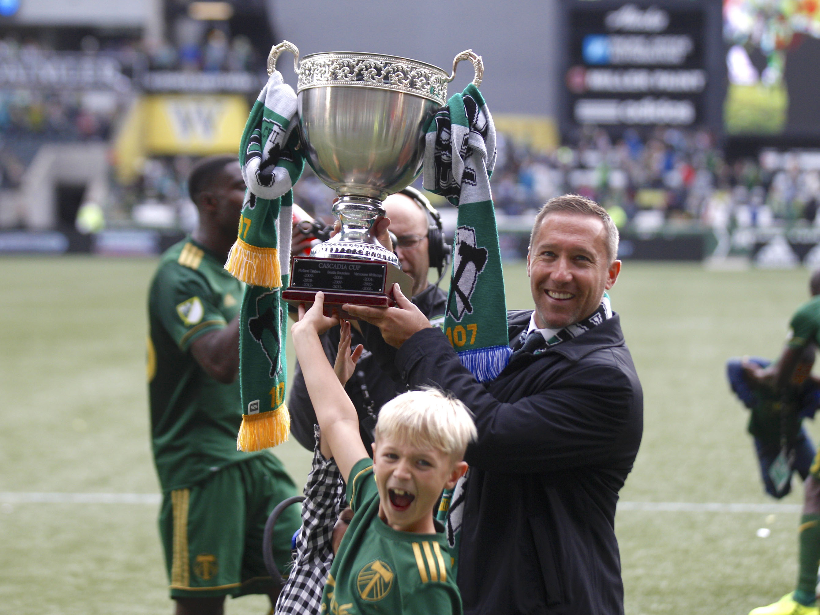 Portland Timbers coach Caleb Porter holds up the Cascadia Cup after the Timbers defeated the Vancouver Whitecaps in an MLS soccer match on Sunday in Portland, Ore. The Timbers won 2-1.