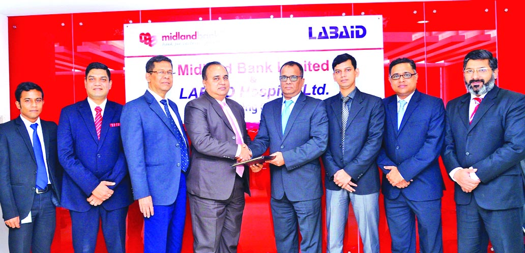 Masihul Huq Chowdhury, AMD of Midland Bank Limited and Al Emran Chowdhury, Chief Operating Officer of Labaid Hospitals, exchanging an MoU signing documents at the bank's head office in the city on ed the on behalf of their respective organizations at a simple ceremony held on Monday. Under the deal, Visa Cardholders and Employees of the bank will enjoy special discount on basic and special health screening package and medical services from the hospitals countrywide.  Senior officials from both the organisations were present.