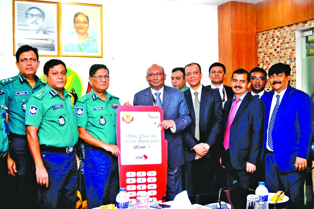 AE Abdul Muhaimen, Managing Director of United Commercial Bank Limited handing over 500 POS machines to DMP Commissioner Md. Asaduzzaman Mia for DMP traffic division at its office in the city on Thursday. Senior officials from both the organizations were also present.