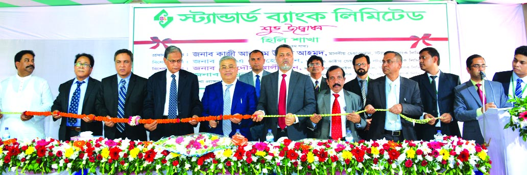 Primary and Mass Education Minister Md. Mostafizur Rahman Fizar, inaugurating the 115th branch of Standard Bank Limited at Fulbari in Dinajpur on Sunday. Kazi Akram Uddin Ahmed, Chairman, Mamun-Ur-Rashid, Managing Director, SAM Hossain, Vice-Chairman, Kamal Mostafa Chowdhury, Ferozur Rahman, Mohammed Shamsul Alam, Md. Zahedul Hoque, Directors of the bank were also present.