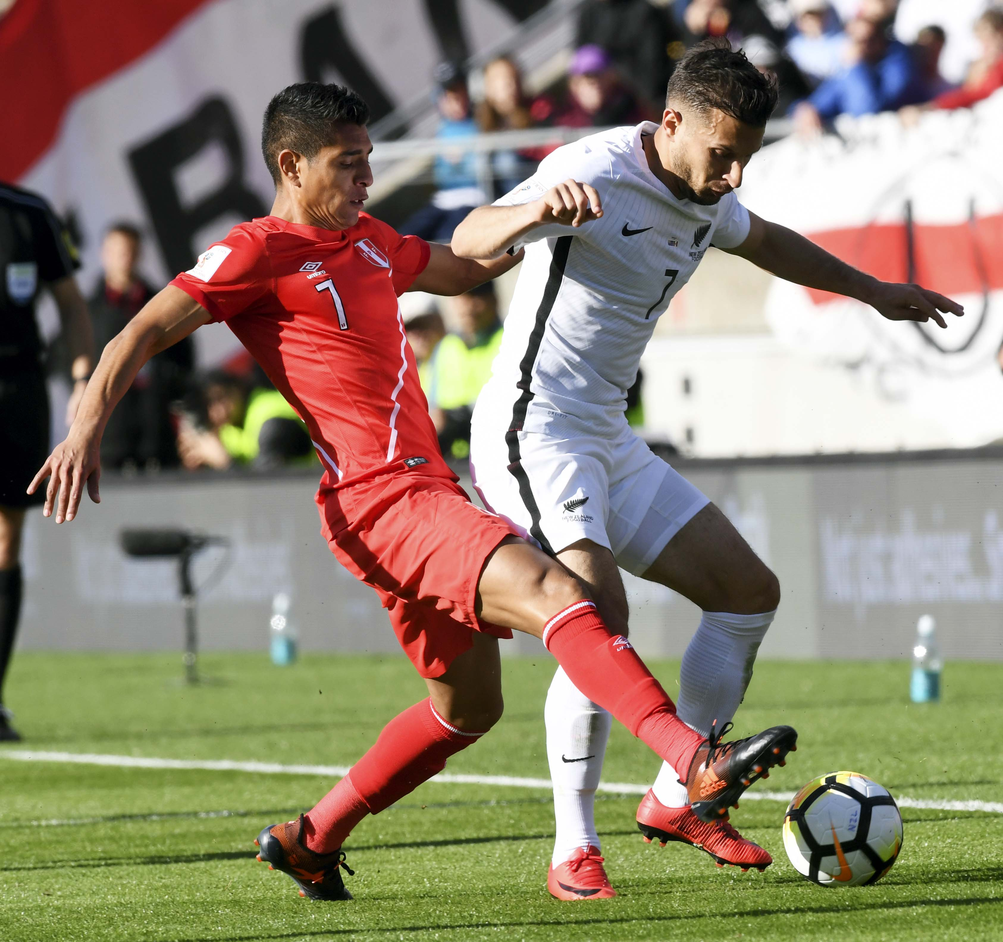 Peru's Paulo Hurtado (left) challenges New Zealand's Kosta Barbarouses for the ball during their World Cup soccer qualifying match in Wellington, New Zealand on Saturday.