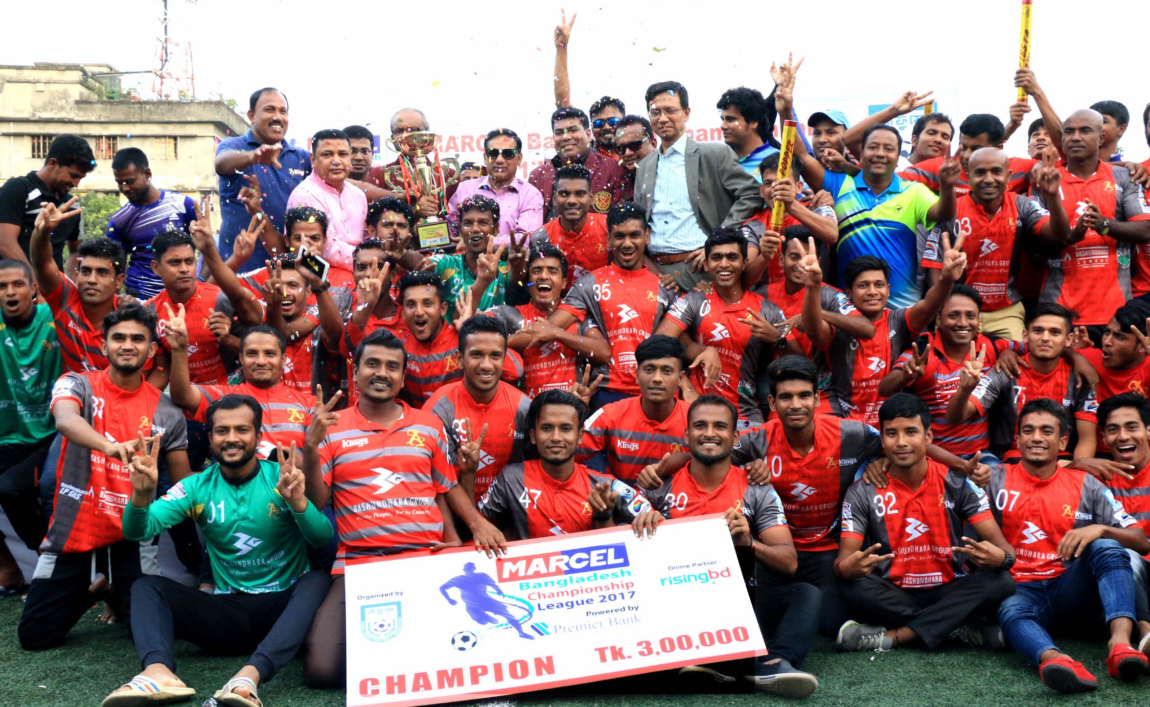 Bashundhara Kings XI, the champions of the Marcel Bangladesh Championship League Football with the guests and officials of Bangladesh Football Federation pose for photograph at the Bir Shreshtha Shaheed Sepoy Mohammad Mostafa Kamal Stadium in the city's Kamalapur on Saturday.