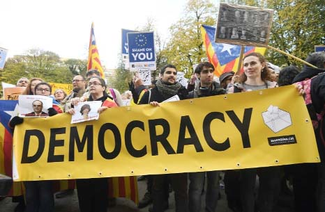 Spain`s Rajoy urges return of `democratic and free` Catalonia