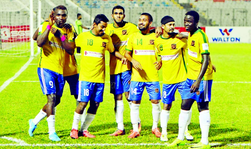 Players of Sheikh Jamal Dhanmondi Club Limited celebrating after scoring a goal against Dhaka Mohammedan Sporting Club Limited during their match of the Saif Power Battery Bangladesh Premier League Football at the Bangabandhu National Stadium on Tuesday. Sheikh Jamal won the match 3-0.