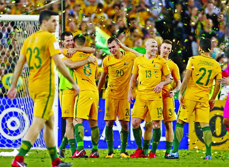 Australian players celebrate after defeating Honduras during their World Cup soccer playoff deciding match in Sydney, Australia on Wednesday.
