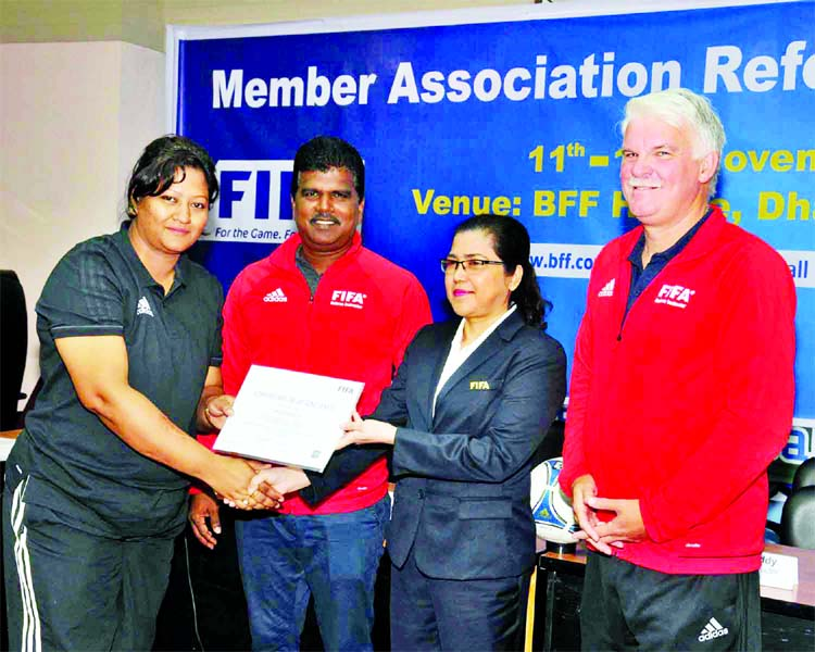 Chairperson of the Women's Committee of BFF Mahfuza Akter Kiron (second from right) handing over a certificate to a participant of FIFA MA Referee's Course at the BFF House on Wednesday.