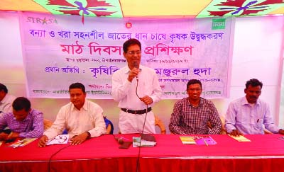 CHAPAINAWABGANJ: Md Monjurul Huda, Deputy Director, District  Agriculture Extension   Department speaking as Chief Guest at an awareness programme on cultivation of drought and flood friendly paddy yesterday.