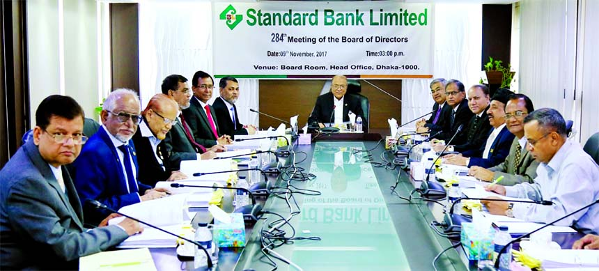 Kazi Akram Uddin Ahmed, Chairman of Standard Bank Limited, presiding over its 284th Board Meeting at its head office in the city on Thursday. Mamun-Ur-Rashid, Managing Director, SAM Hossain, Vice-Chairman, Kamal Mostafa Chowdhury, Ashok Kumar Saha and Ferozur Rahman, Directors of the bank were also present.
