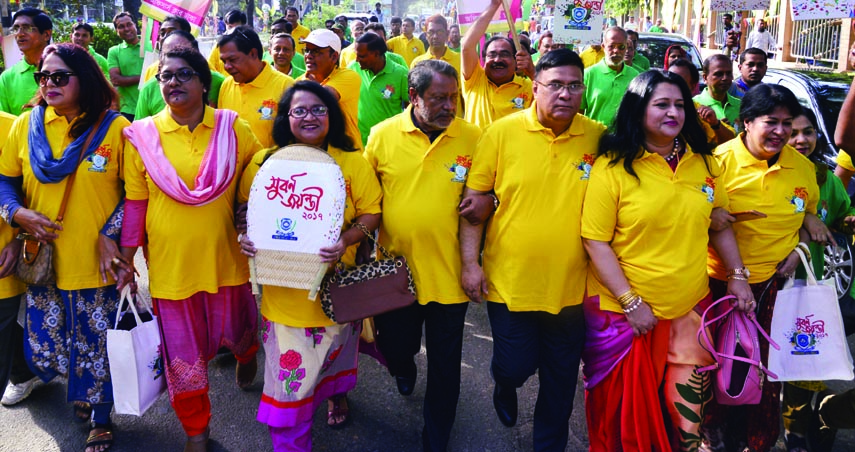 Members of Officers' Club, Dhaka brought out a rally in the city on Saturday marking the golden jubilee of the club.