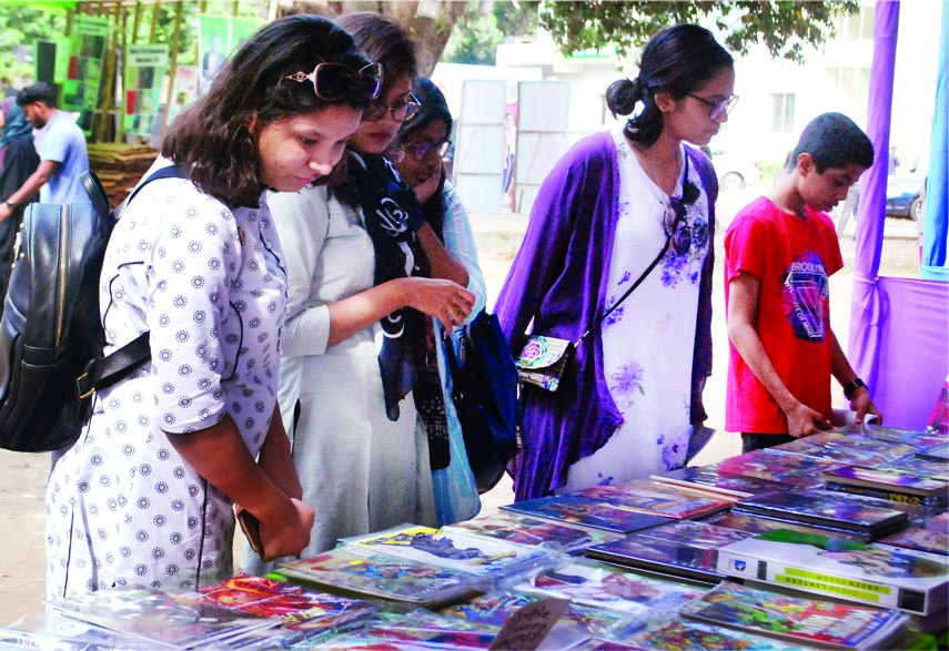 Buyers at a book stall set up on the occasion of Dhaka Lit Fest-2017 on Bangla Academy premises in the city on Saturday.