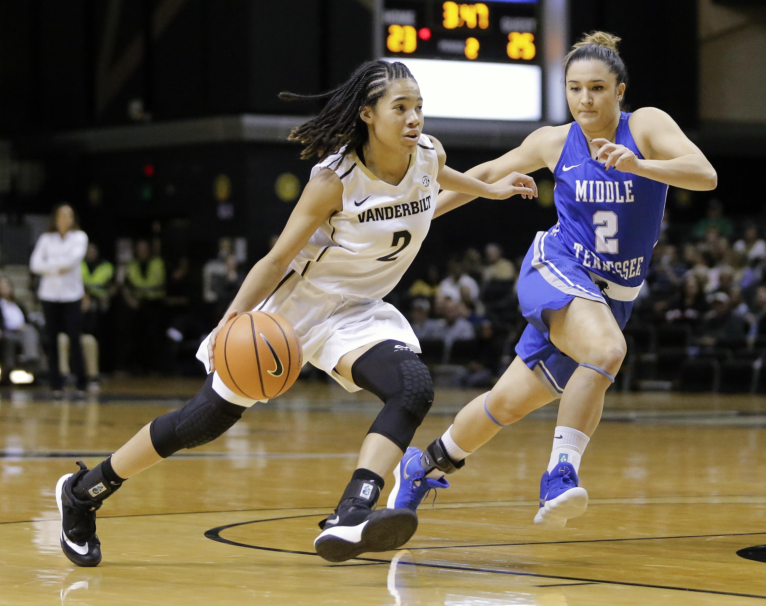 Vanderbilt guard Chelsie Hall (left) drives against Middle Tennessee guard Zeynep Canbaz (right) in the first half of an NCAA college basketball game on Friday.