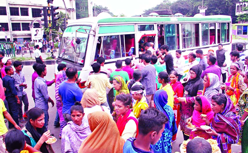 People crowding to aboard a bus as no bus available in the Capital due to Citizen's Conference at Suhrawardy Udyan on Saturday, causing sufferings to commuters and home-goers. This photo was taken from city