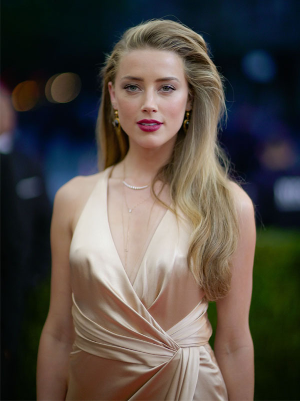 Amber Heard feels being a role model is a burden