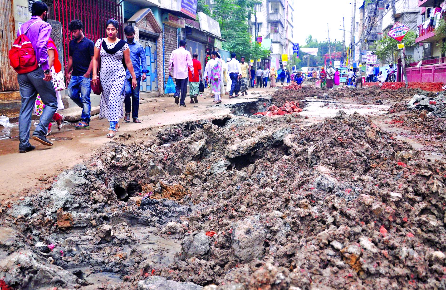 When the pain becomes never-ending! Unplanned and uncoordinated digging of roads in different city areas is going on for a long time making the dwellers' daily life miserable, causing sufferings to commuters every day. But nobody knows when it will end as the utility providers do not bother about anguish of the people. The photo was taken on Sunday from city's Badda area.