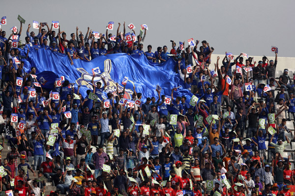 Supporters of Dhaka Dynamites enjoying Bangladesh Premier League (BPL) T20 Cricket match at the Sher-e-Bangla National Cricket Stadium, Mirpur on Monday.