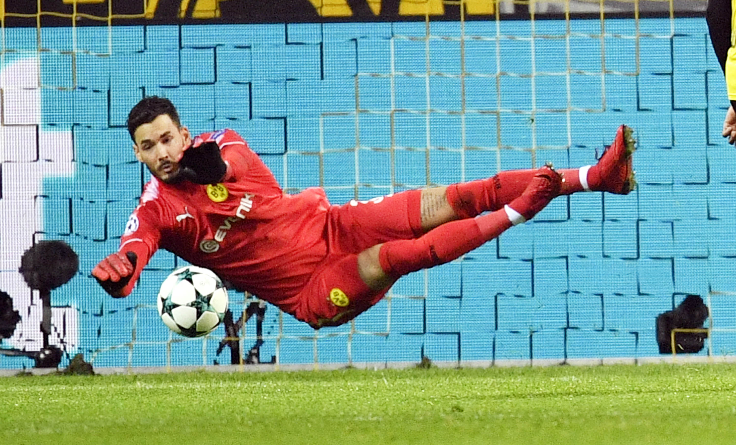 Dortmund goalkeeper Roman Buerki makes a save during the soccer Champions League group H match between Borussia Dortmund and Tottenham Hotspur in Dortmund, Germany on Tuesday.