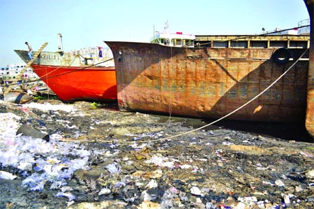 Apart from damaging ecological balance, the water of the Buriganga River is getting polluted every day due to mixing of used paint, chemicals, burnt oil and other substances that come from ship repairing workshops. This photo was taken from Keraniganj area on Wednesday.