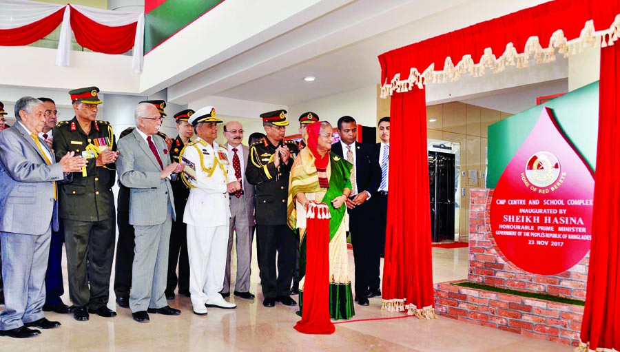 Prime Minister Sheikh Hasina along with other distinguished persons at the inaugural ceremony of CMP Center and School Complex at Savar Cantonment on Thursday.