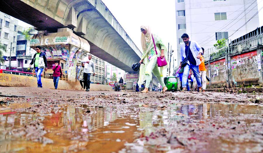 A portion of the main thoroughfare underneath the Hanif Flyover turned to be a dangerous place to pass through even there is a short spell of rain causing immense sufferings to pedestrians. This photo was taken from in front of Jatrabari Thana on Sunday.