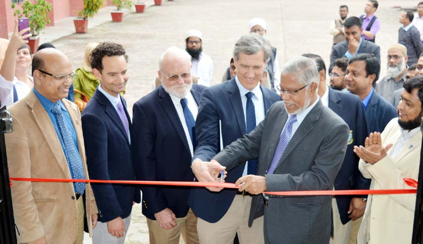 Professor Dr. Jasimuddin Khan, acting vice-chancellor and Pro-vice chancellor of Bangladesh Agricultural University and Dr. Alex Winter-Nelson, Director, ADM Institute for the prevention of Postharvest Loss, University of Illinois at Urbana-champaign in USA Inaugurates the Advanced Drying Lab and Advanced Storage lab as apart of research collaboration entitled Post-harvest loss Reduction Innovation Lab(PHLIL) at the Dept. of Farm Power & Machinery of BAU in Mymensingh on Monday.