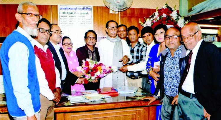 Newly elected executive members of 'Dhaka Sangbadik Paribar Bahumukhi Samabaya Samity Limited' at the charge taking ceremony in the Jatiya Press Club on Tuesday.