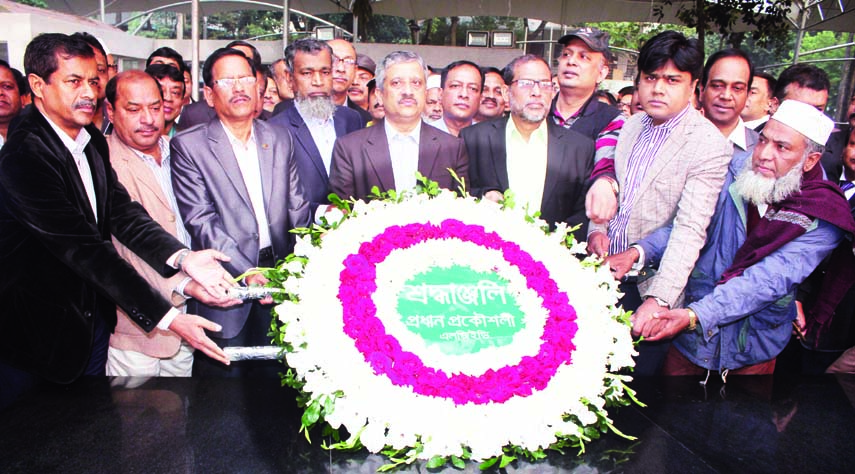 Newly-appointed Chief Engineer of LGED Md Abul Kalam Azad along with high  officials placing wreaths at the portrait of Bangabandhu Sheikh Mujibur Rahman at Bangabandhu Memorial Museum in the city yesterday.