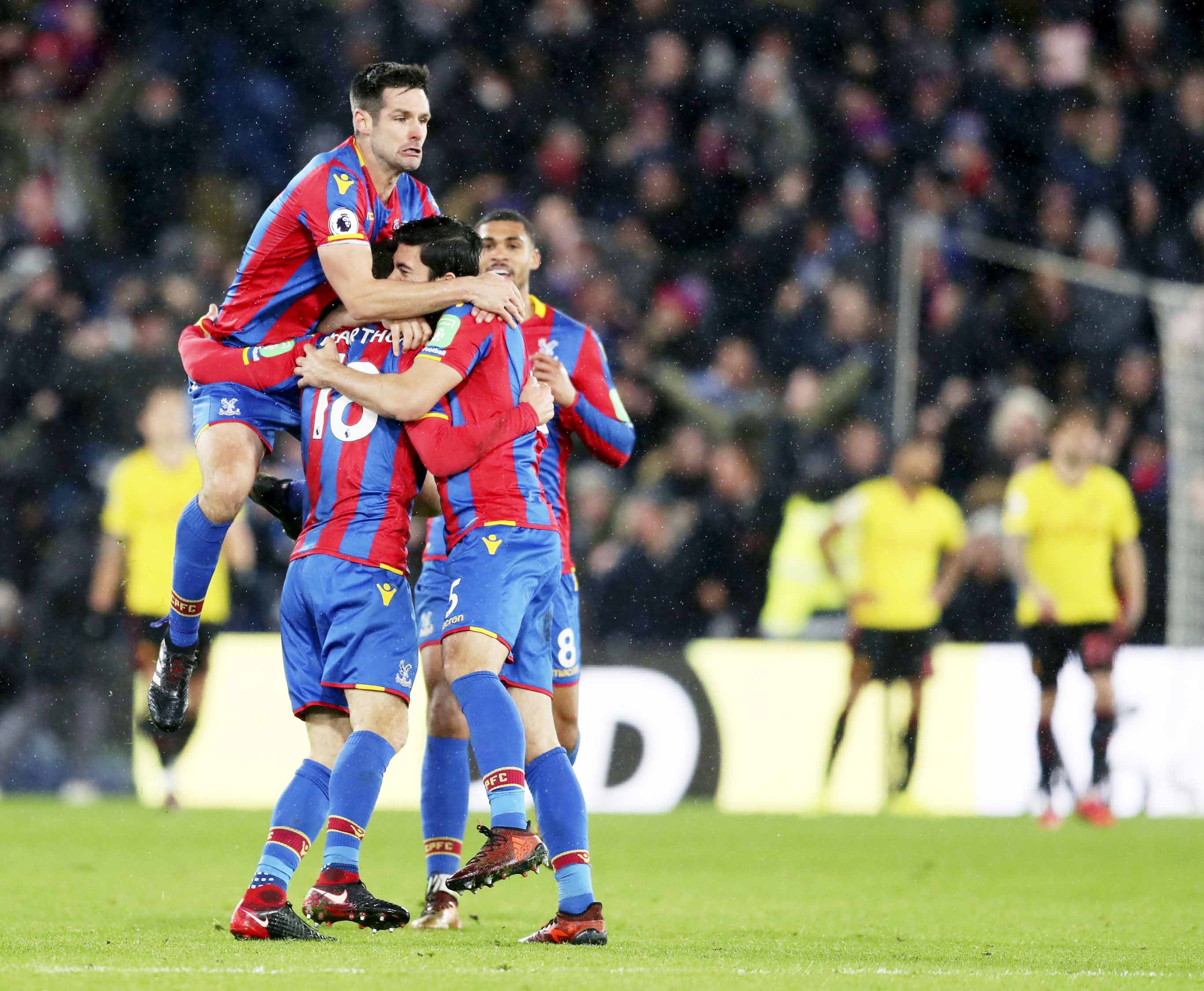 Crystal Palace's James McArthur (centre) celebrates scoring his side's second goal of the game with team-mates during the English Premier League match between Crystal Palace versus Watford at Selhurst Park, London on Tuesday.