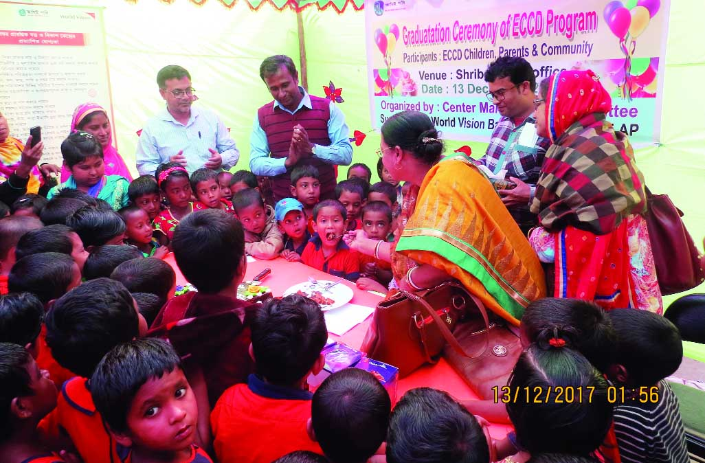 SREEBARDI (Sherpur): Aruna Rai, Education Officer, Sreebardi Upazila feeding cakes to the  children at the graduates ceremony and  Early Childhood Care and Development ( ECCD) Programme supported by World Vision, Bangladesh and ADP at Sreebardi ADP office premises yesterday.