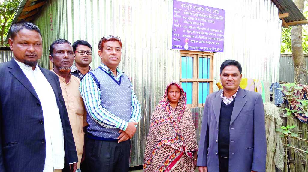 KURIGRAM: Hiader Ali Mia, Chairman, Ulipur Upazila Parishad distributing tin-shed houses  among the poor people at  the Upazial organised by Tobakpur Samaj Klayan Sangstha recently.
