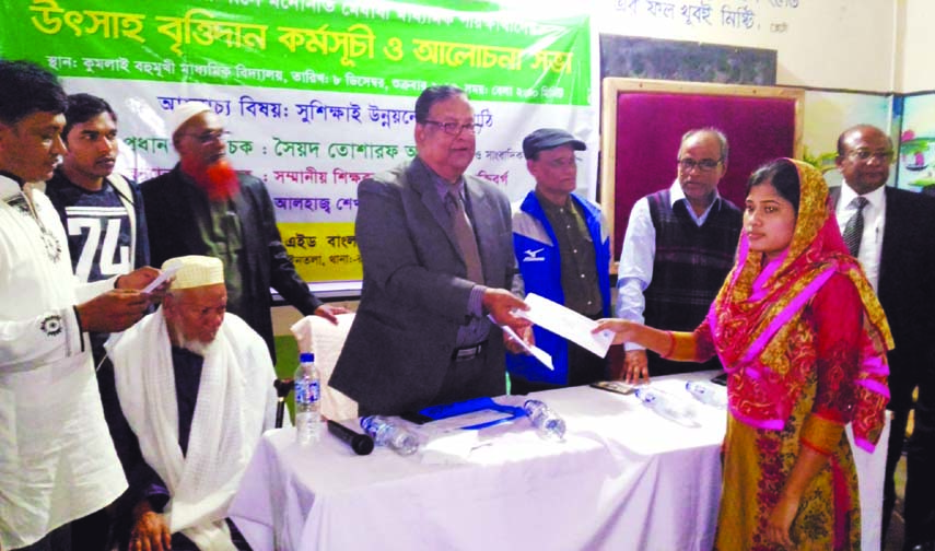 Veteran journalist and columnist Syed Tosharaf Ali handing over stipend among the meritorious students of Kumlai Multilateral Secondary School in Bagerhat recently. Retired District Judge Sheikh Jalal Uddin was present, among others, on the occasion.