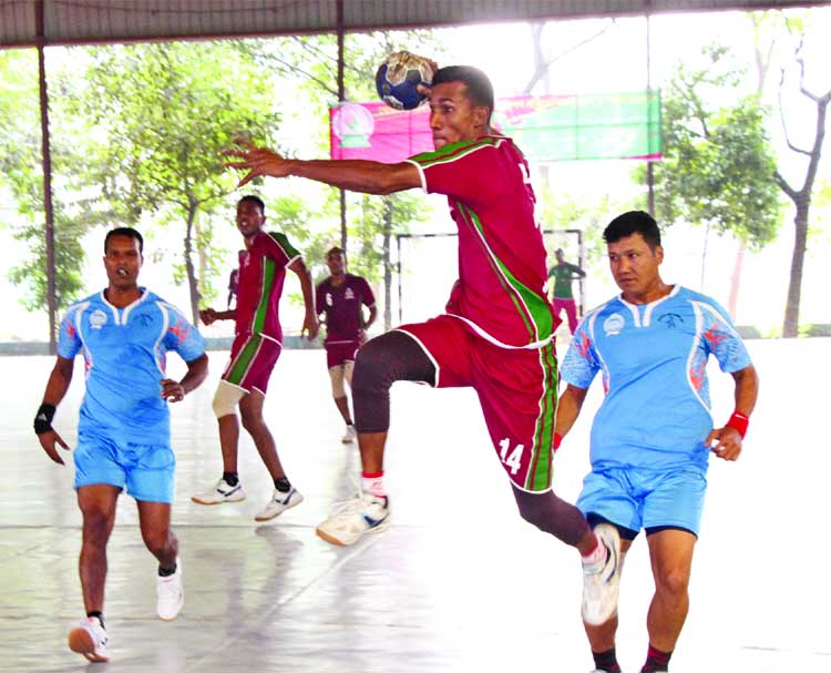 A moment from the match of the Men's Division of the Khokon-Udayan Builders Victory Day Handball Competition between Border Guard Bangladesh and Bangladesh Police at the Shaheed (Captain) M Mansur Ali National Handball Stadium on Friday. Border Guard Bangladesh won the match by 27-22 goals.
