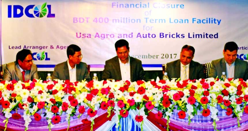 S.M. Monirul Islam, Deputy CEO of Infrastructure Development Company Limited (IDCOL), SM Formanul Islam, CEO of Bangladesh Infrastructure Finance Fund Limited (BIFFL) and Ayub Ali Khan, Managing Director of USA Agro and Auto Bricks Limited (UAABL), signing and tripartite Term Loan Facility Agreement at a city hotel in the city recently. Senior officials from each organization were present.
