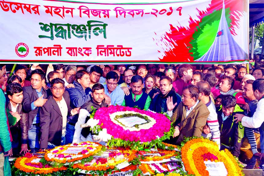 Md. Ataur Rahman Prodhan, Managing Director of Rupali Bank Limited, placing a wreath at the portrait of  Bangabandhu Sheikh Mujibur Rahman at Dhanmondi 32 on Saturday marking the 47th Victory Day. Hasne Alam, Morshed Alam Khondokar, DMDs and other officials of the bank werer present.