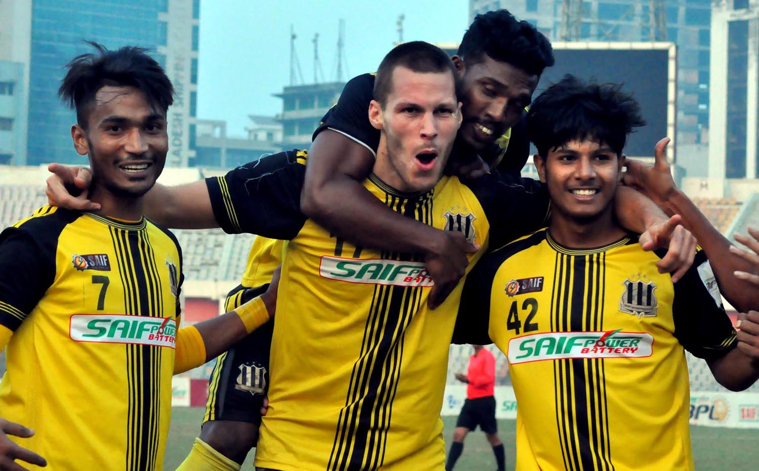 Players of Saif Sporting Club celebrating after defeating Chittagong Abahani Limited by three goals to nil in their match of the Saif Power Battery Bangladesh Premier League Football at the Bangabandhu National Stadium on Sunday.