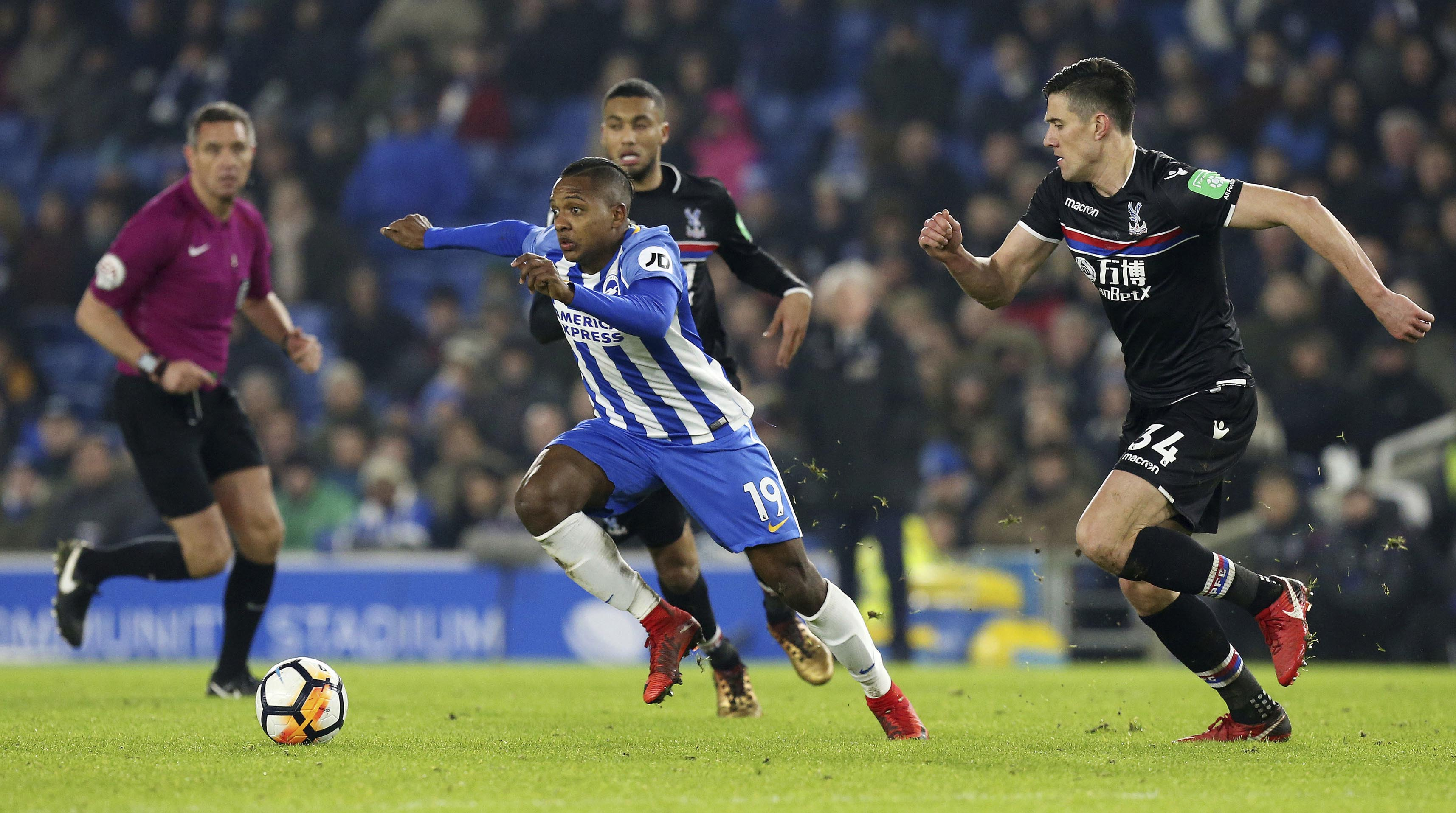 Brighton & Hove Albion's Jose Izquierdo breaks through Crystal Palace's Martin Kelly, right, and Jairo Riedewald, during their English FA Cup, Third Round soccer match at the AMEX Stadium in Brighton, England on Monday.