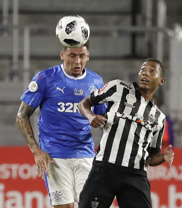 Glasgow Rangers' James Tavernier (left) goes against Atletico Mineiro's Leleu during the first half of a Florida Cup soccer match on Thursday.