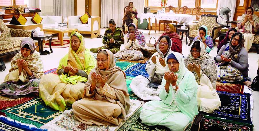 Prime Minister Sheikh Hasina, among others, offering `Akheri Munajat`in the first phase of Bishwa Ijtema from Ganobhaban on Sunday.