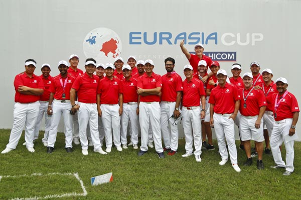 Team Asia pose for a group photo during the EurAsia Cup golf tournament at Glenmarie Golf & Country Club in Shah Alam, Malaysia on Sunday.