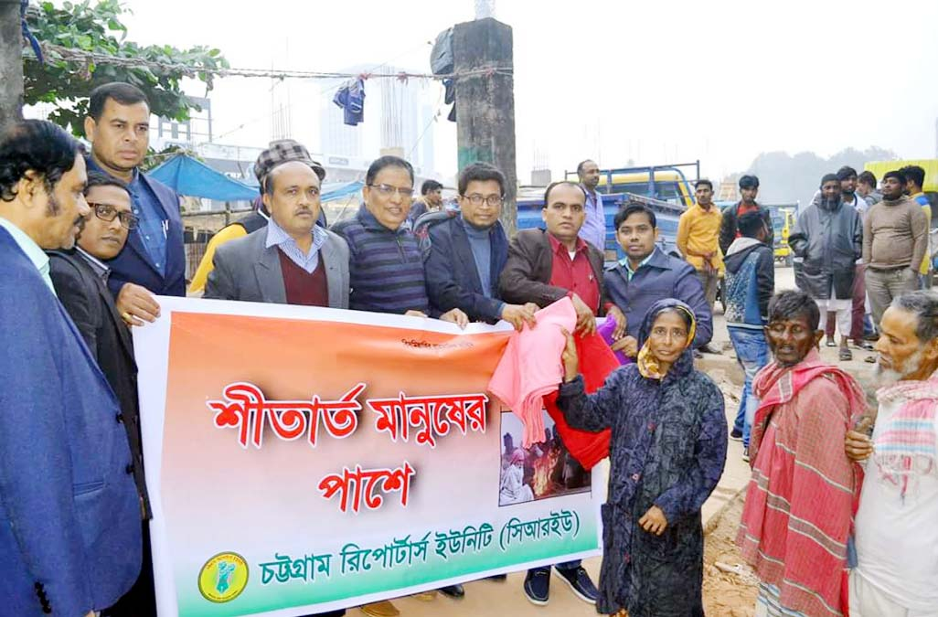 CRU leaders distribute blankets among cold -hit people