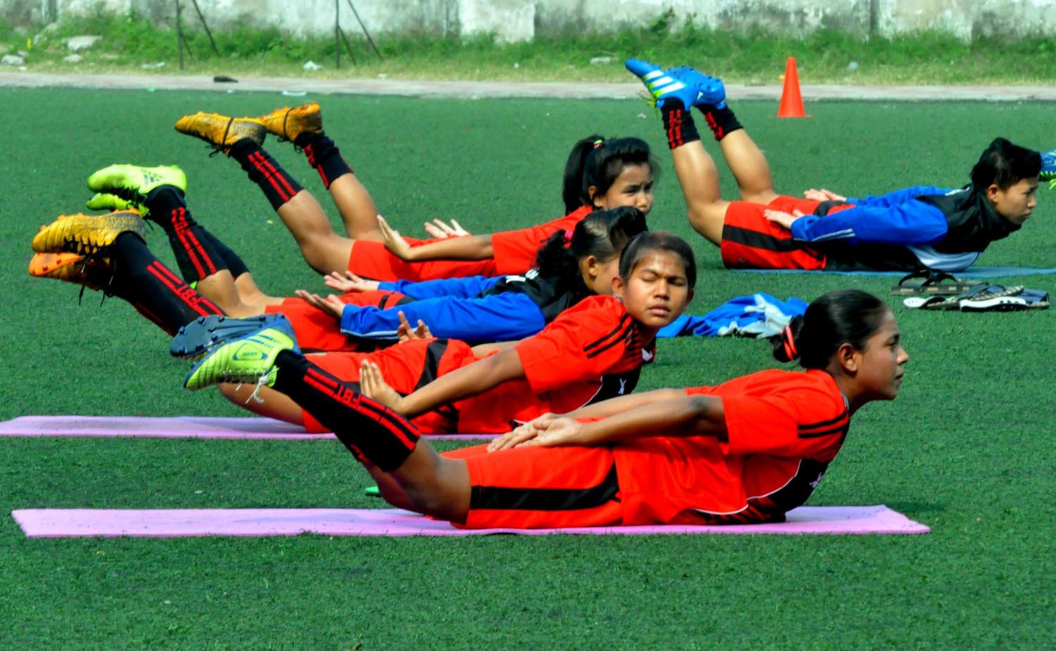Players of Bangladesh Women's Football team during their practice session at the BFF Artificial Turf on Monday.