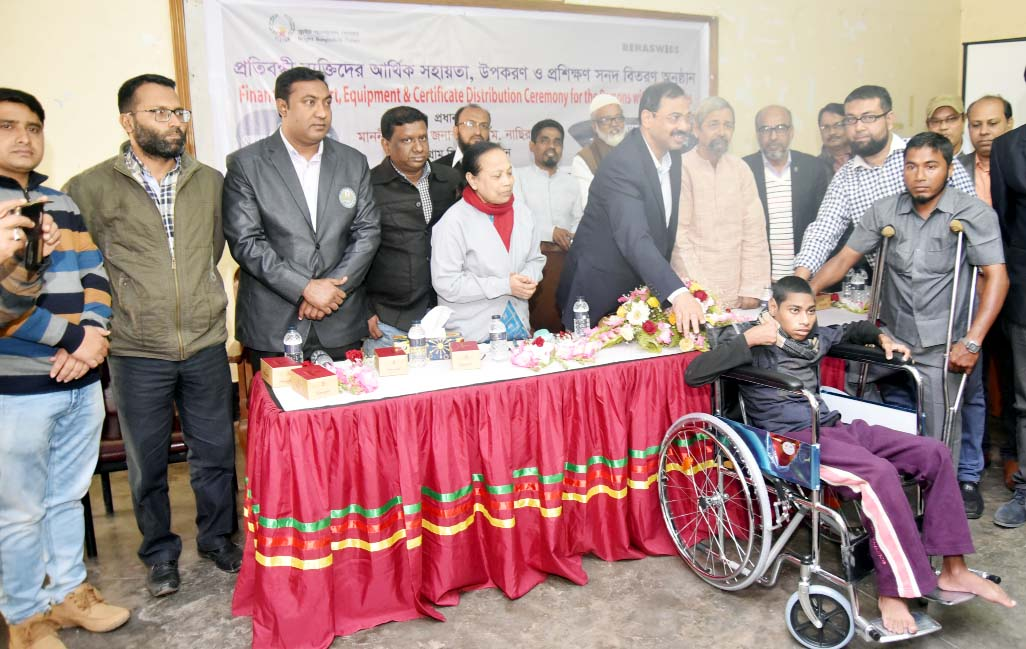CCC Mayor A J M Nasir Uddin  distributing wheel chairs among some disabled children organised by Bright Bangladesh Forum  at the Port City on Sunday.