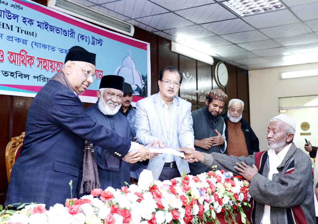 Chairman of  PHP family Alhaj Sufi Mizanur Rahman  distributing cheque among the destitute people on behalf  of Syed Ziaul Hoque Maizbhandari Trust  on Saturday.