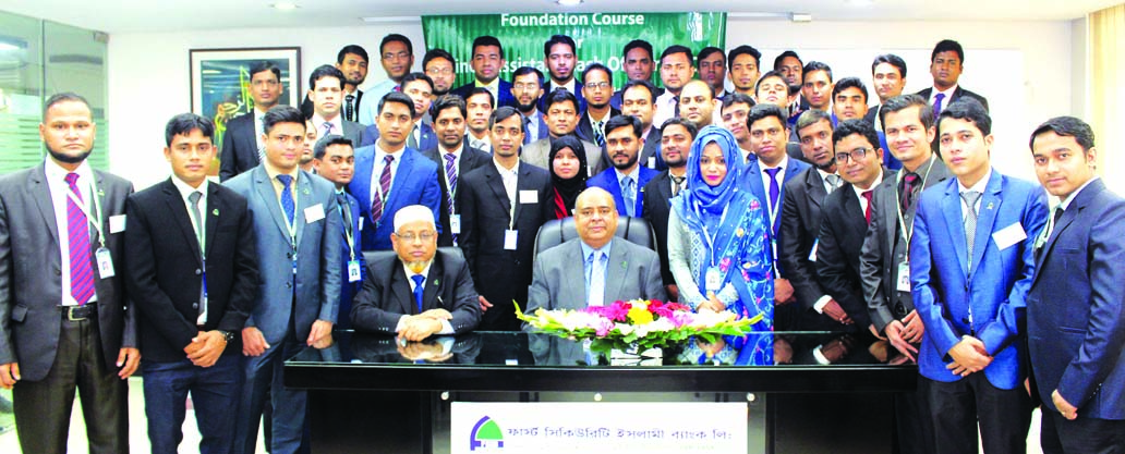Syed Waseque Md. Ali, Managing Director of First Security Islami Bank Limited, poses with the participants of the 28th Foundation Course at its Training Institute in the city recently. Senior officials of the bank were present.