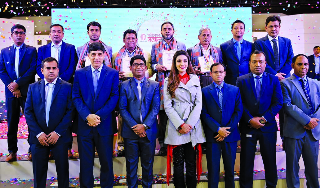 Ahsan Khan Chowdhury, Chairman and CEO of PRAN-RFL Group, poses with the participants at its Dealers' Conference at RFL Industrial Park at Kaliganj in Gazipur on Sunday. More than 2500 distributors, engaged to serve Sera, Sticky, Saudi, Comfy, Playtime, Italtech, Support and Rainbow branded products, took part at the conference. RN Paul, Managing Director of RFL Group and Kamrul Hasan, Chief Operating Officer of Rainbow Paints were also present.