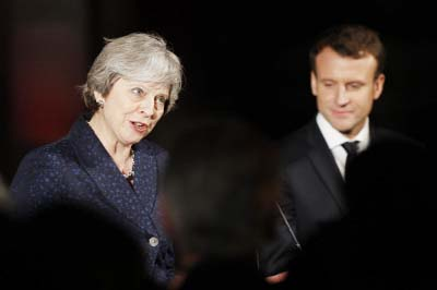 May, Macron strike border security deal at UK summit