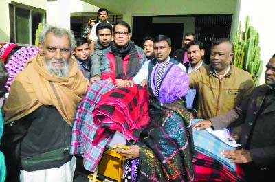 DINAJPUR (South): BRAC, Fulbari Unit distributing winter clothes among cold-ht  people  on Thursday.