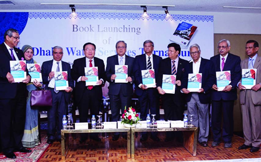 Forest and Environment Minister Anisul Islam Mahmud along with other distinguished persons holds the copies of a book titled 'The Dhaka Water Services Turnaround' at its cover unwrapping ceremony organised jointly by Asian Development Bank and Dhaka WASA at Hotel Sonargaon in the city on Thursday.