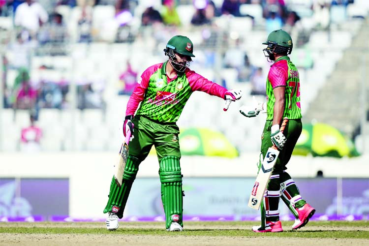 Shakib Al Hasan (right) congratulates his teammate Tamim Iqbal after scoring fifty runs during the Tri-Nation One Day International cricket series against Sri Lanka at the Sher-e-Bangla National Cricket Stadium in Mirpur on Friday.